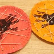 Halloween Kids Craft: Handprint Spiders in a DIY Lacing Card Web