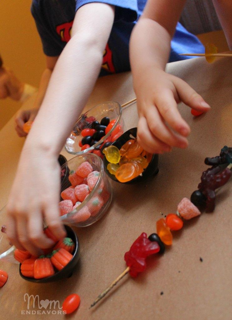 Making Halloween candy kabobs