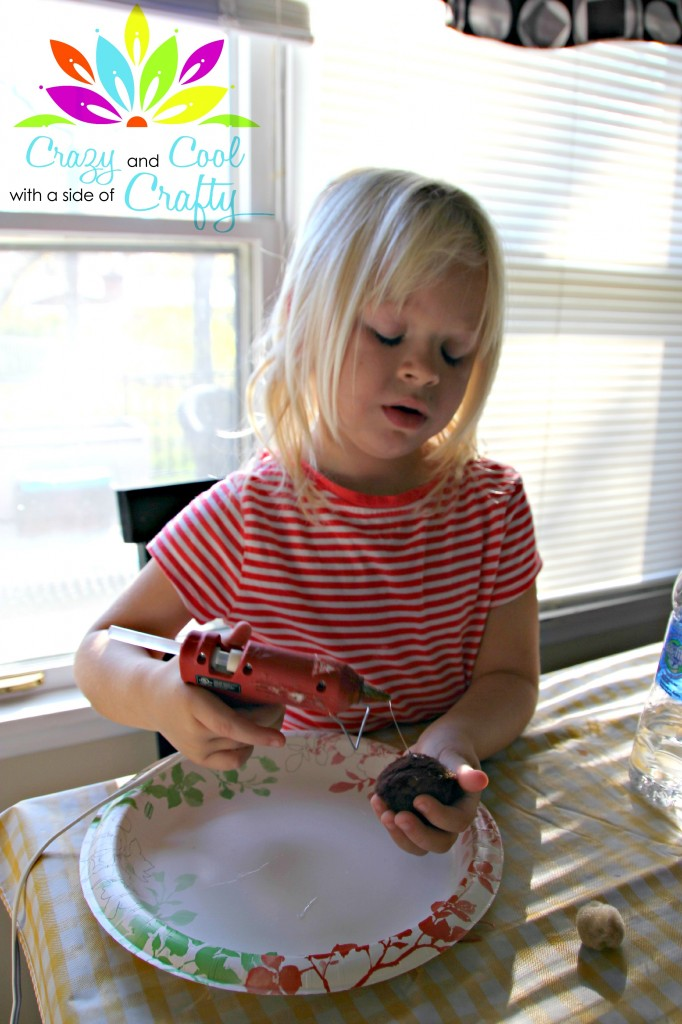 Caelyn working with the glue gun via CrazyCoolCrafty