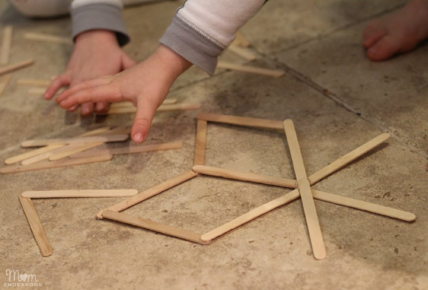 Making popsicle stick snowflakes