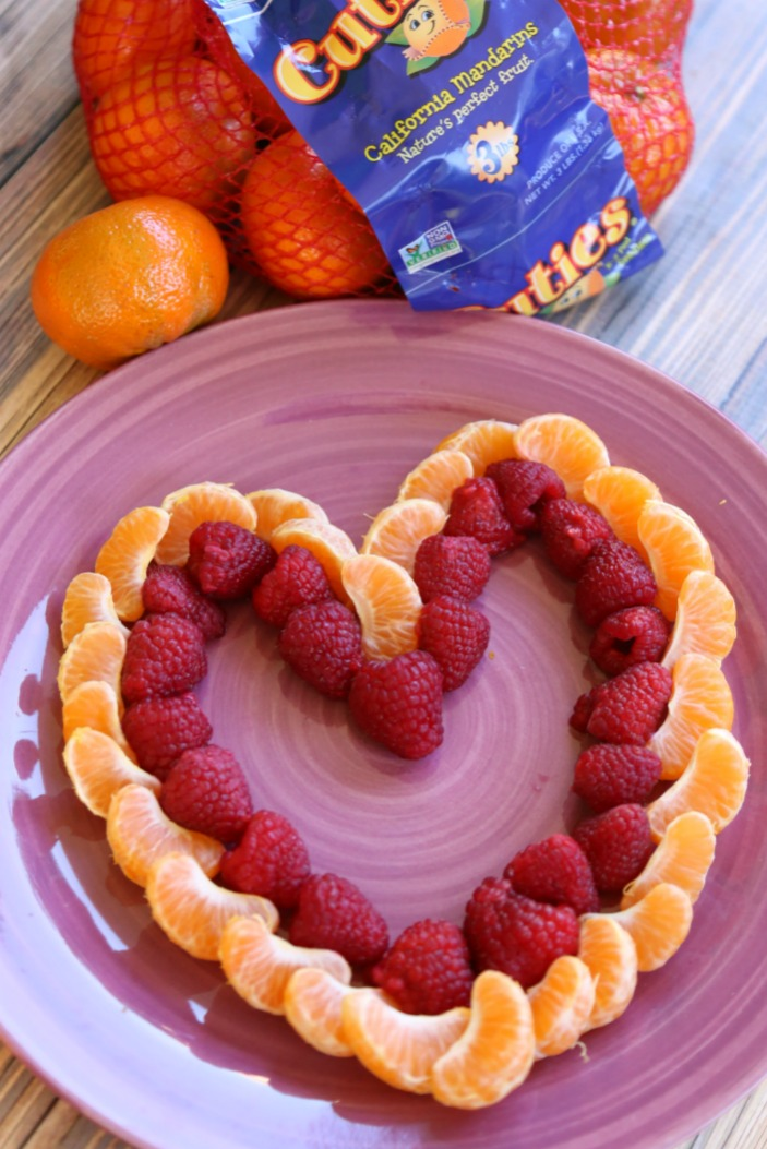 Making a heart-shaped fruit platter