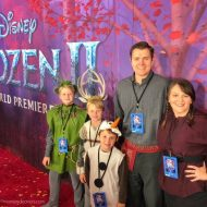 Family dressed in costume on Frozen 2 Red Carpet