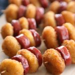 Fried cheese curds and sausage bites on toothpicks