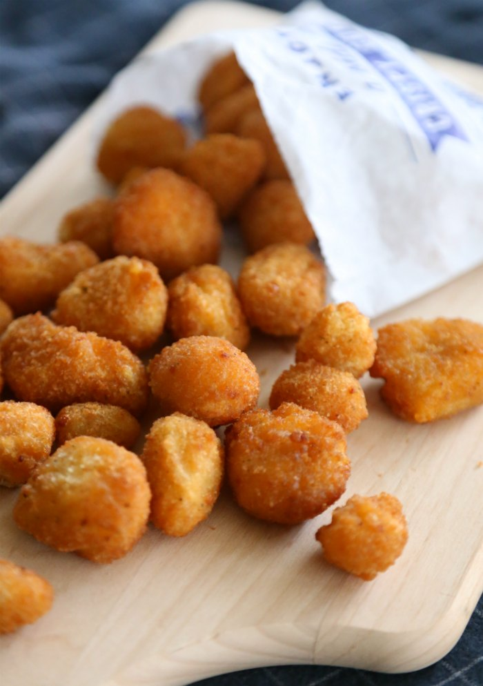 Fried Cheese Curds on a wooden serving tray
