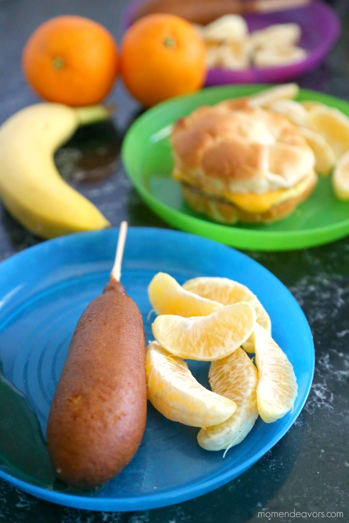 Pancake Sausage Stick with oranges on a kids' plate