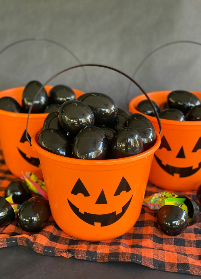 Pumpkin buckets filled with black eggs